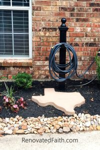 DIY Hose Holder - DIY Landscape Design – Want to save money by landscaping your yard but don't know where to start? Planning your own landscape design can be overwhelming but these simple front yard landscaping ideas will give your yard a professional look without while staying on budget. #frontyardlandscapingideas #frontyardlandscapingideaswithstones #landscapearchitecture #smallfrontyard www.renovatedfaith.com