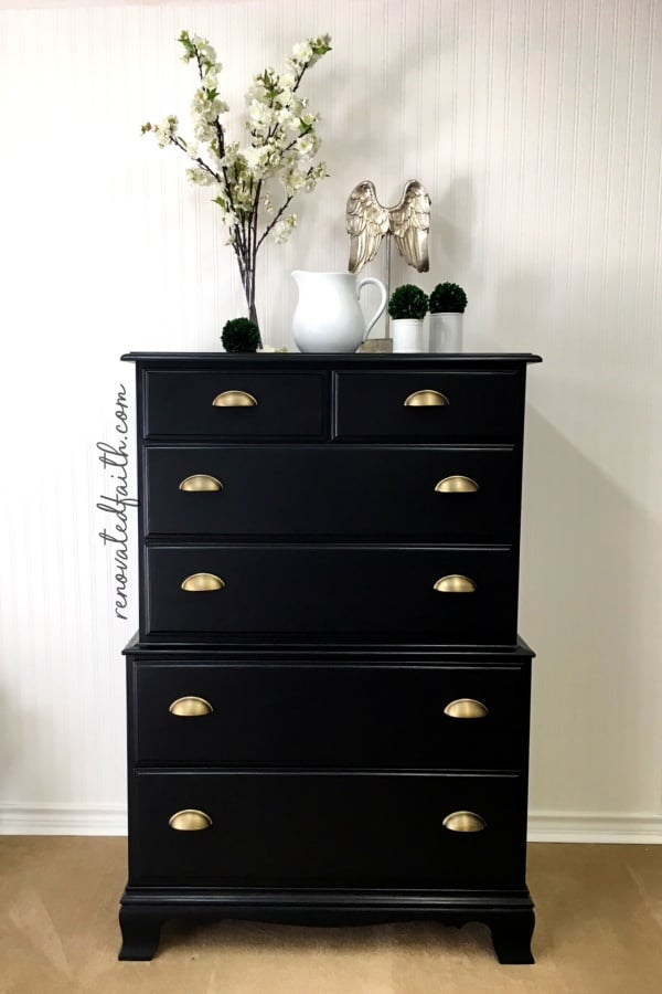 black dresser with champagne pulls