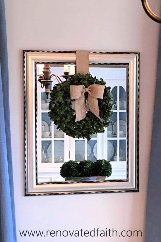 "Should I DIY or buy?  Here are 5 tips to help you decide whether to buy or make your next home decor item, as well as the best way to ""make"" a boxwood wreath.  How to make an artificial boxwood wreath. DIY preserved boxwood wreath.  How to make a real a real boxwood wreath. #boxwoodwreath #preservedboxwood #boxwoodsprigs"