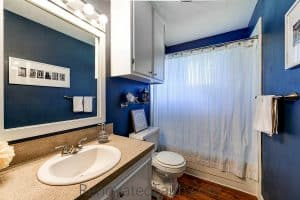 Blue Bathroom - Tips for Selling Your House Fast - Do you want to maximize the return on your investment when updating your home to sell? Do you wish you could shorten the amount of time your home is on the market? Sure you do. I'm sharing my best tips for selling your house fast which helped our old house to get 24 showings and 12 offers within the first 24 hours. How To Get Your House Ready To Sell. Home Selling Tips 2018. How To Sell Your House Fast in a Slow Market. #sellhouse #stagingchecklist #tipstosellhouse