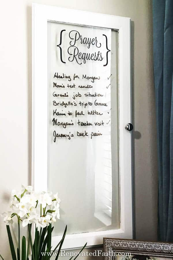 prayer request board hanging on wall