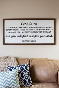 black and white sign with Bible verse