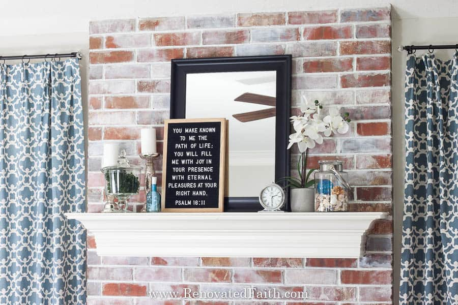How to Whitewash a Brick Fireplace (Faux German Smear with Paint!)