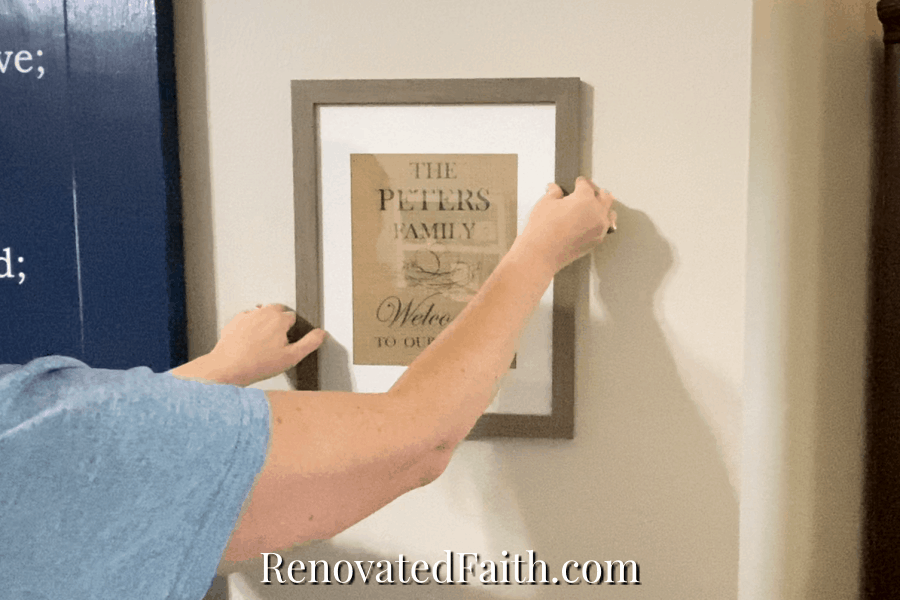 how to hang pictures evenly