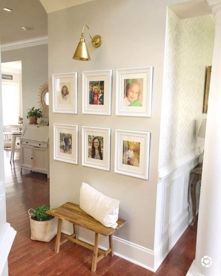 Sherwin Williams Agreeable Gray entryway with Gold lighting and wood