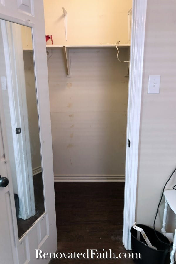 before of walk in closet with desk